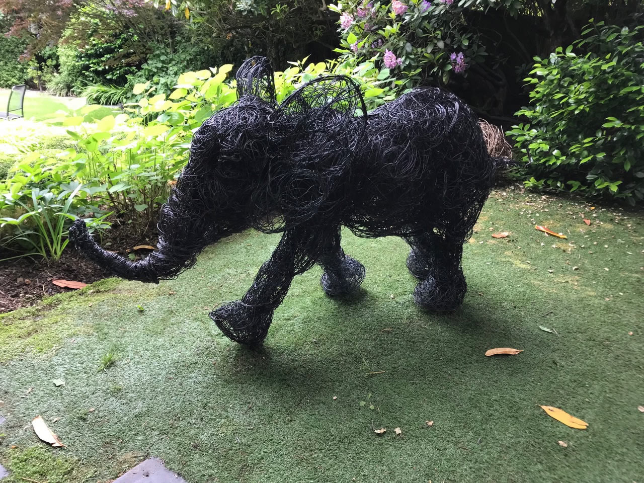 Jumbo, copper wire sculpture baby elephant seen at the 2018 Chelsea Flower Show installed in a garden in Hampstead, North London